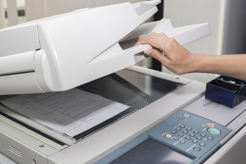 Xerox machine woman making copies