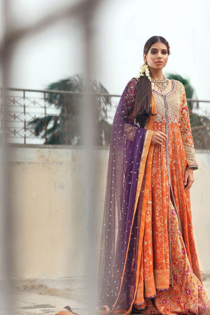 Pakistani Mehndi Dress by Sana Abbas Features this Rust Khaddi Silk net Pishwas
