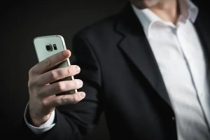 Real estate agent holding a phone