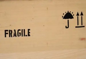 """Boxes marked """"fragile"""" such as this grey wooden box are great, and that's why you should buy packing supplies."""