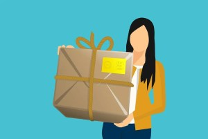 A cartoon girl holding a box she found to save money on relocation assistance Florida movers provide