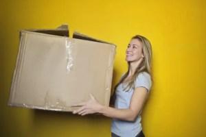Woman holding a big box.