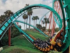 People riding a roller coaster at Busch Gardens.
