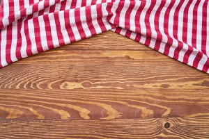 A red and white rag on the wooden floor