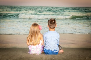 The back pose on the beach with children
