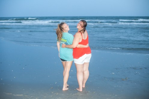 Sisters posing on the beach
