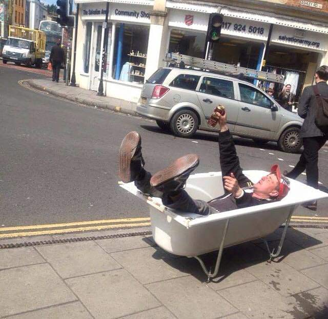 Man in a bath in Stokes Croft