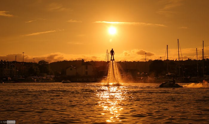 sunset flyboarder