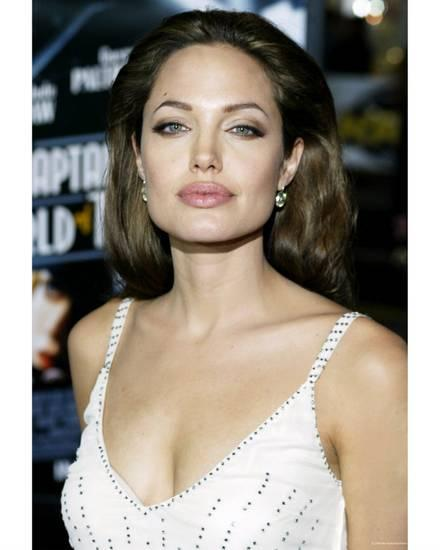 Angelina Jolie sexy cleavage in white