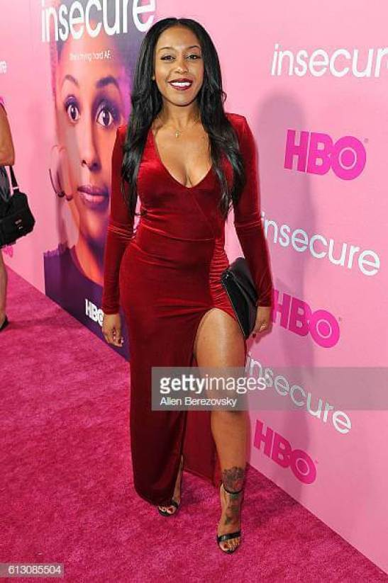 DomiNque Perry sexy red dress