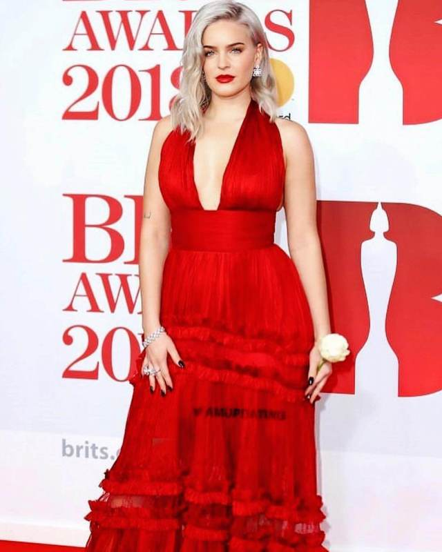 Anne-Marie Singer sexy red dress