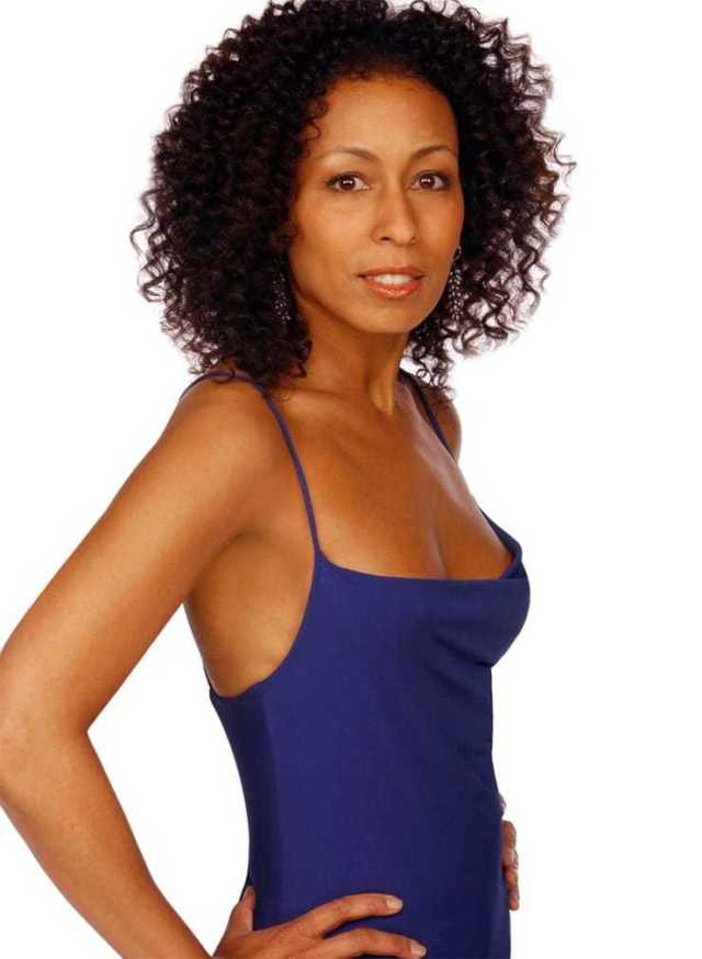 Tamara Tunie sexy cleavage pictures