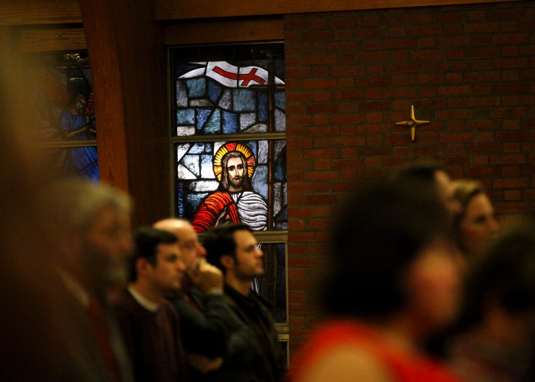 A light from outside illuminates one single stained- glass window at St. Francis, one of Jesus. St. Francis X Cabrini holds what may be the final service at St. Francis on Christmas Eve, Dec. 24, 2015. Wicked Local Staff Photo/Alyssa Stone
