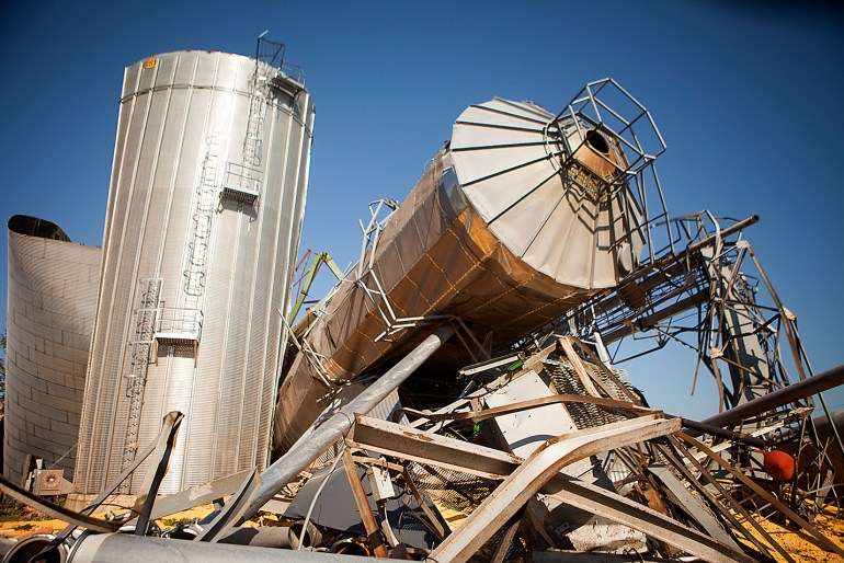 The twisted wreckage of several grain bins lie in a heap the morning after a tornado swept through Cameron, Illinois on July 17, 2015. STEVE DAVIS/The Register-Mail