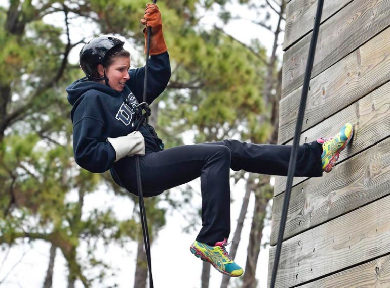 Saugus High School director of guidance, Leanne Mottola rappels off the 50 foot Holberton Tower when educators from around New England got a chance to experience what life would be like for Marine recruits during the Marine Corps Educator Workshop at Parris Island in South Carolina on Wednesday, Feb. 25, 2015.