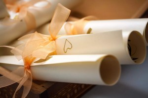 Wedding invitation card in rolls with wooden box, closeup