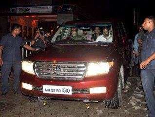 Amitabh Bachahn with Abhishek Bachchan in his car