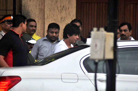 Shaheukh Khan travelling in his White BMW Car