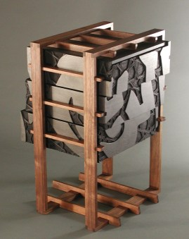 The relief calligraphy wraps around all four sides of the black cube. I imagined these drawers sitting on a desktop, where they could be seen in the round, like a sculpture.