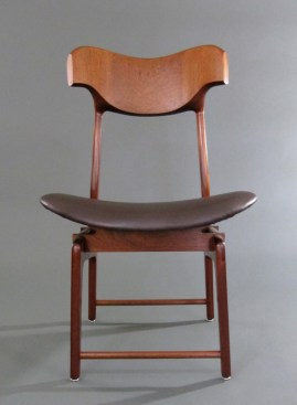 Quality faux leather is stretched over bent layers of oval plywood to make the seat.