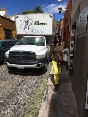 Jet Metier walking down a narrow street in Mexico