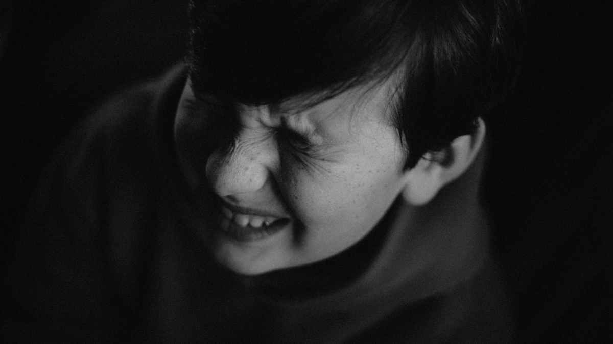 grayscale photo of boy