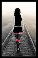 cute alone and stylish girl in a railway track