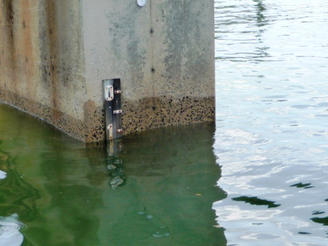 Lake Norman Bridge support with water level marker
