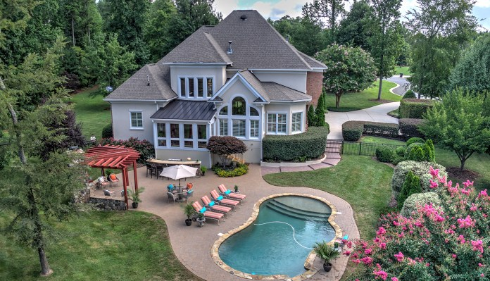 Pool and rear view of the listing in The Point