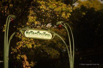 Subway sign in the sunset light along the Parc Monceau, Paris