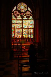 Praying at the Notre Dame de Paris at sunrise