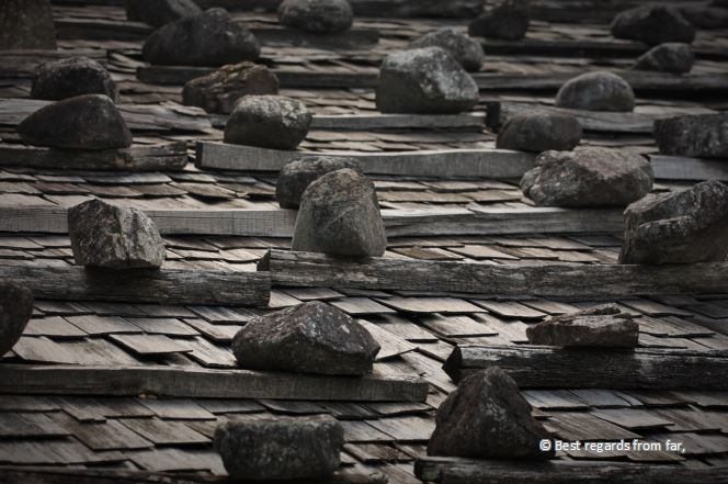 Stones holding traditional wooden roofs, Tsumago
