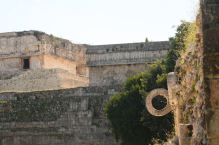 The ball court hoop with the Governor's Palace in the background, Uxmal, Mexico