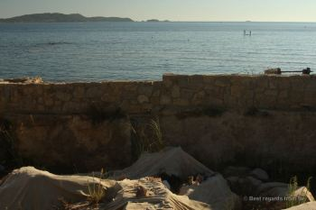 The ruins of Olbia with the pier slightly sticking out of the water, French Riviera