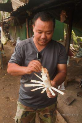 Mr. Ola showing how to peel the bamboo sticky rice, Battambang, Cambodia