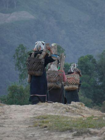 Women going home after working the fields, Akha village trekking, Laos