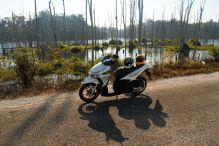 The 125cc rental scooter with the Thalang lake, the loop, Laos