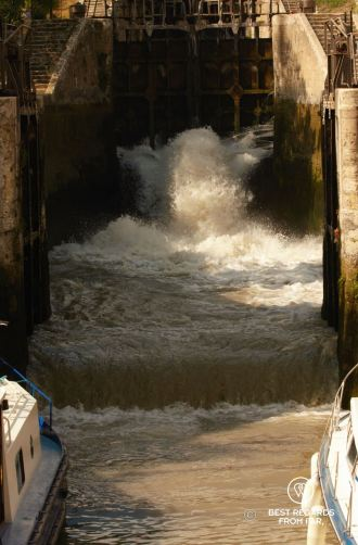Water flooding the lower lock to lift boats, the locks of Fonseranes, Béziers