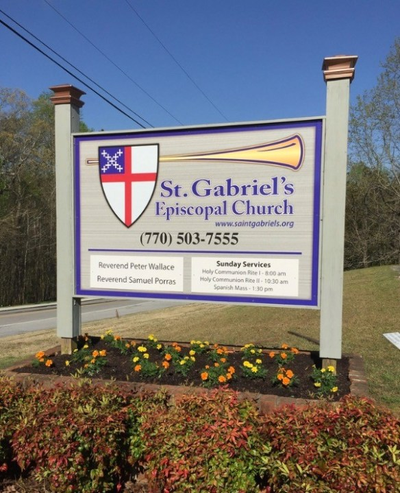Saint Gabriel's Church aluminum sign panel to look like sandblasted sign, with changeable service hours and pastor name.