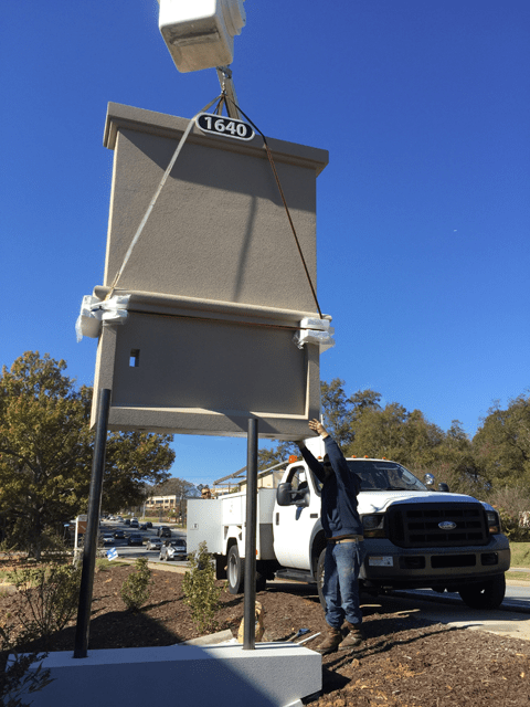 Sign Monument With Bucket Truck To Lift In Place