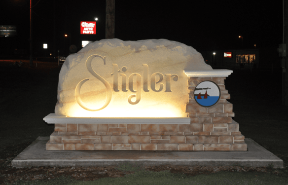 Stigler City Entrance Sign Monument Night Time View Illuminated