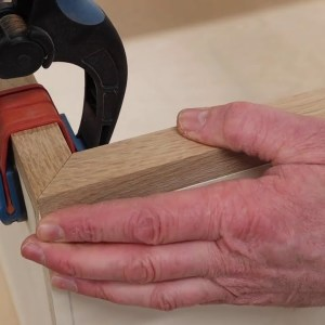 A Simple Sacrificial Fence = Perfect Miters with no Tear Out, Quick Tip