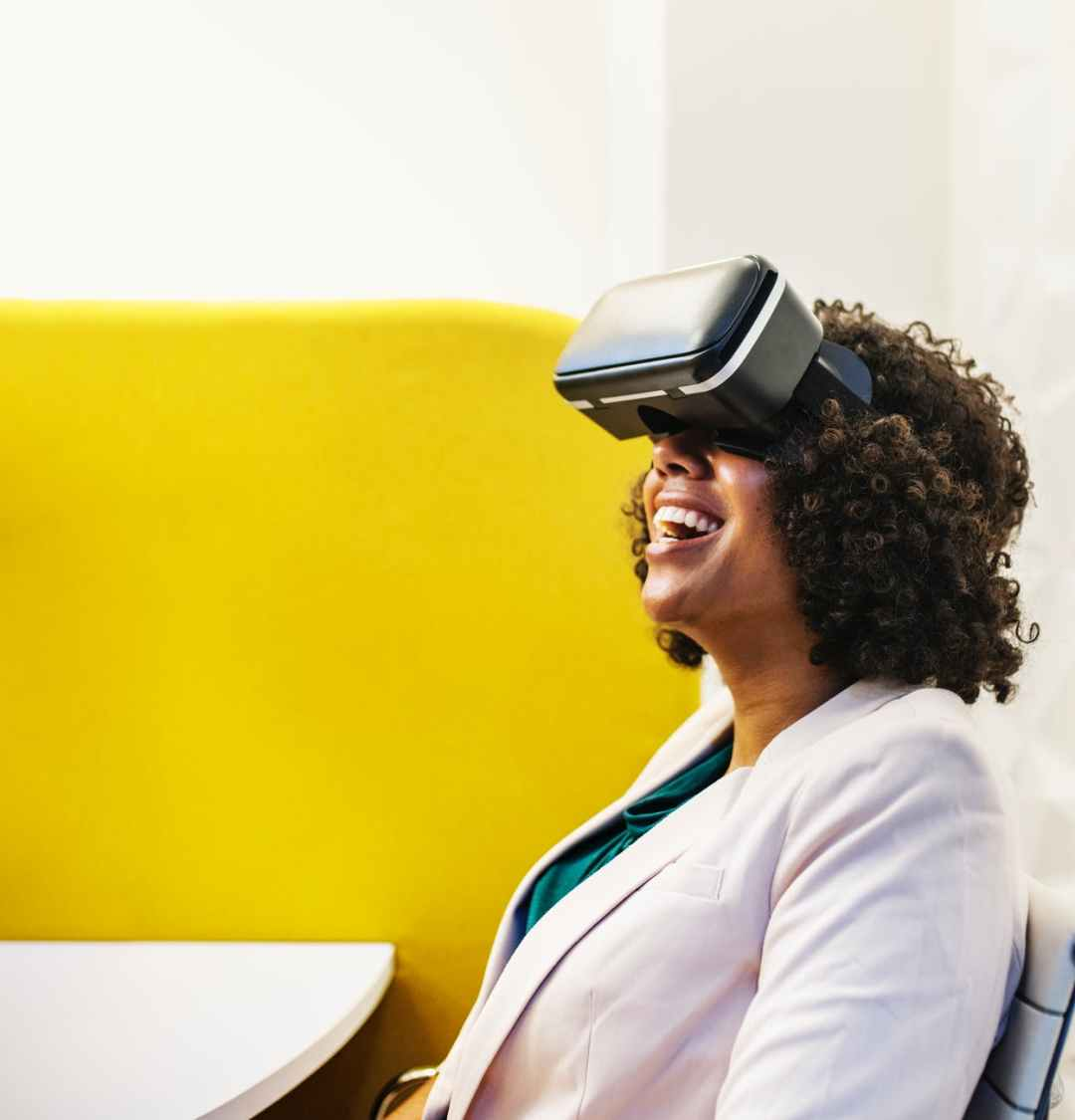 smiling woman using virtual reality headset