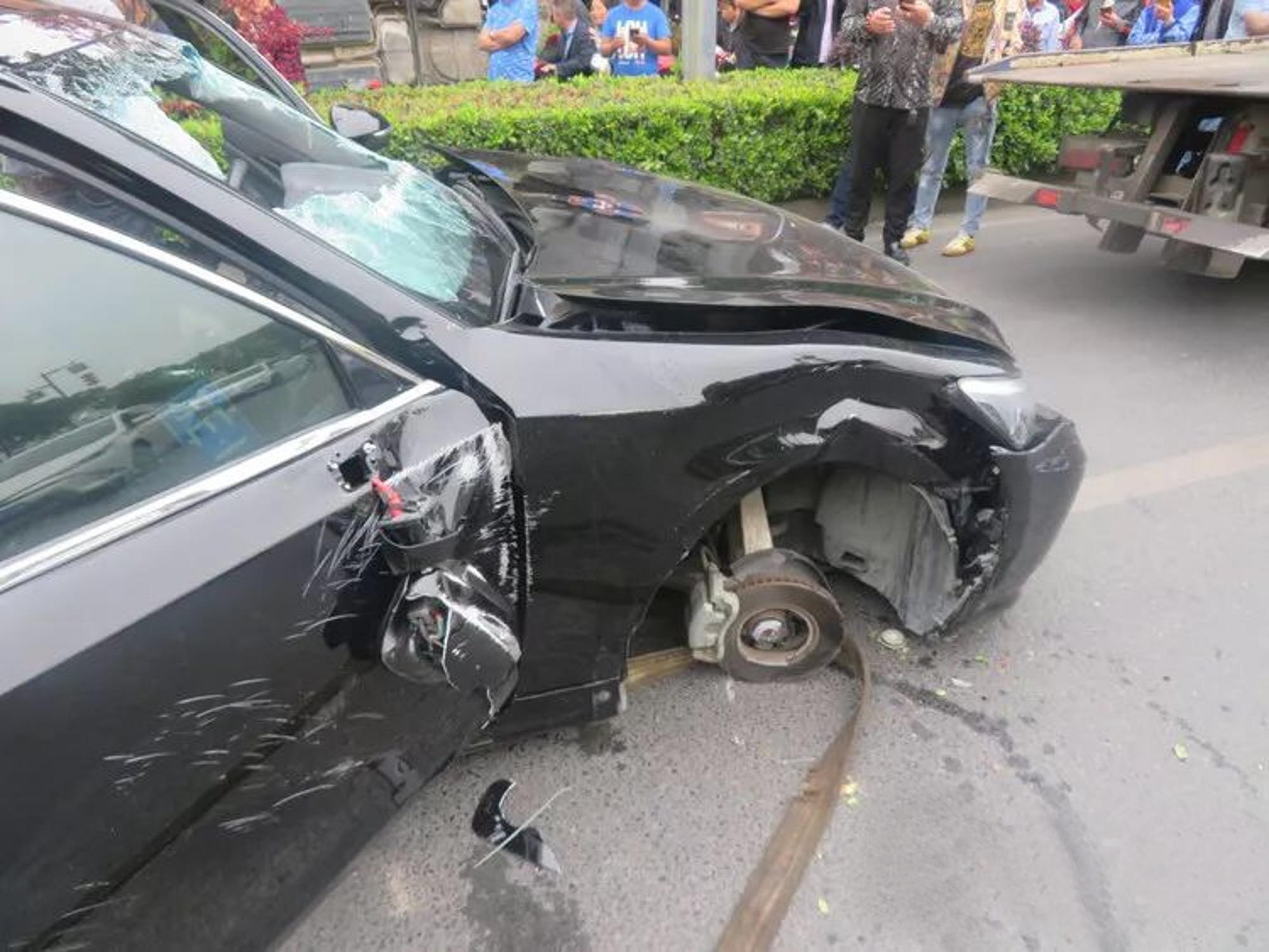 The black Toyota was sent careering off the road and over a traffic island. Credit: AsiaWire