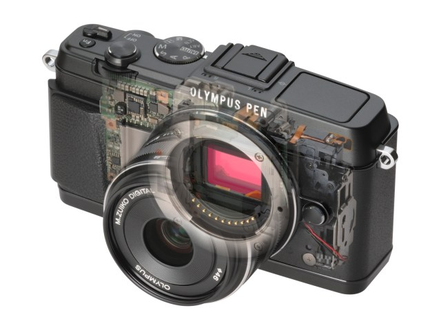Inside an Olympus mirrorless camera - notice nothing intervenes between the lens and the sensor except the (invisible) shutter.