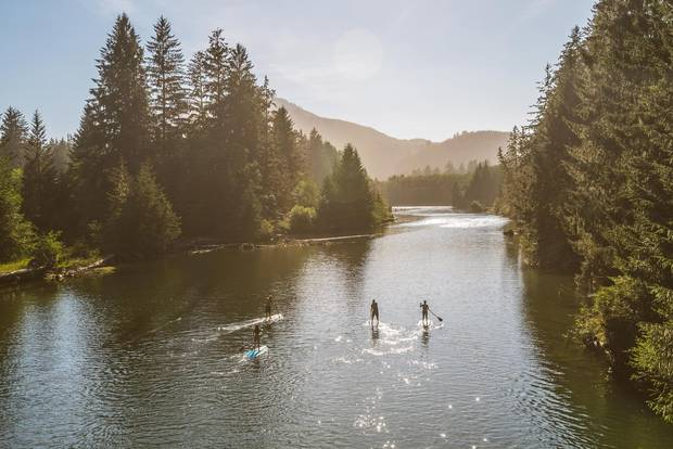 Paddle boarders can navigate up the San Juan River from where it flows into the Pacific Ocean near Port Renfrew, B.C., to Fairy Lake and Lizard Lake.