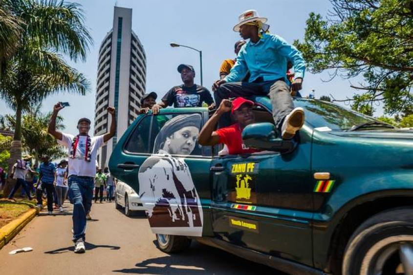 Supporters of Zimbabwean President Mugabe travel the streets by party headquarters on Nov. 8 in a show of support for Grace Mugabe, the President's wife, to become the country's next vice-president – a notion that has spurred opposition from many.