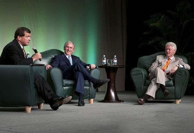 Frank McKenna, left, with former U.S. presidents George W. Bush and Bill Clinton in Toronto.