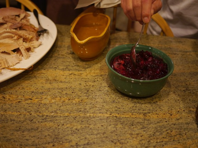 Digging into the cranberry sauce