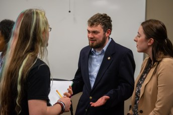 Candidates Aidan Ruch and Kelsey Williams speaking with a student club leader after the debate. | Photo by Jake Van Loh